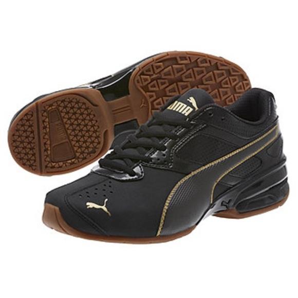 94768e9711fc0b PUMA Tazon 6 FM Running Shoe - Black Team Gold. M 5b9154a9dcf85592d64f1e92